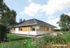 Projekt domu Cetyniec - dom parterowy z garażem, na planie litery L, z nowoczesnymi detalami