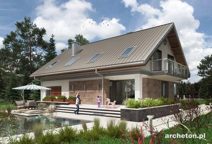 Projekt domu Rudi - dom o prostej sylwetce, z użytkowym poddaszem, przekryty dachem dwuspadowym, z garażem